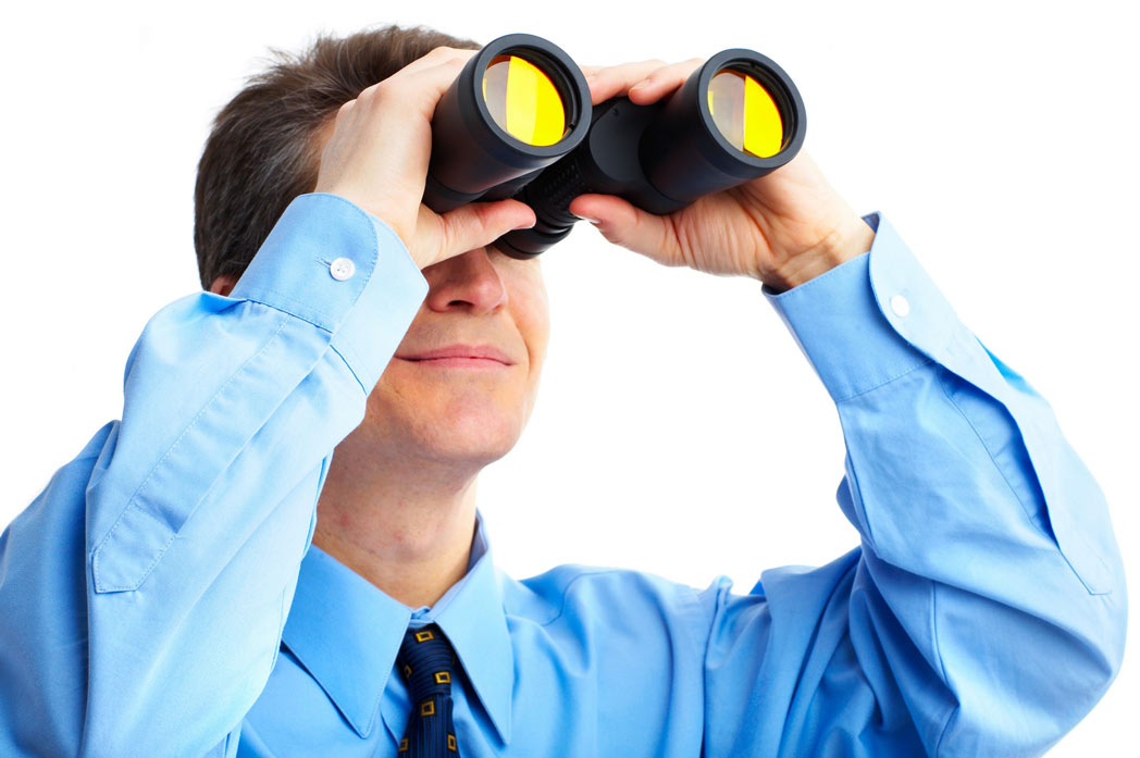 Business man using binoculars