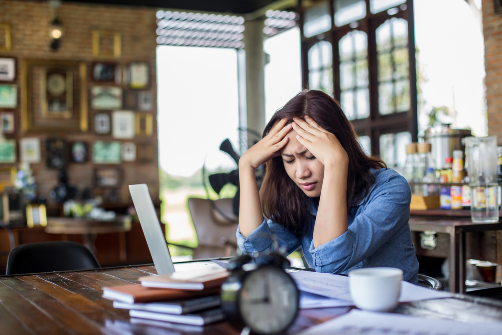 Female manager suffering from stress at her desk