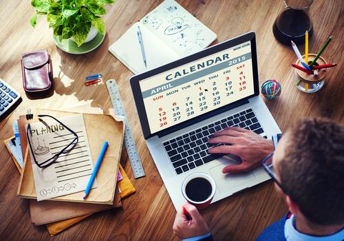 Business man organises his calendar